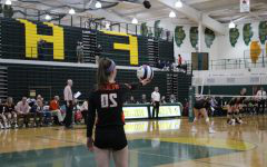 Hopper holds up the ball as she gets ready to serve it over onto the Vikings' side.
