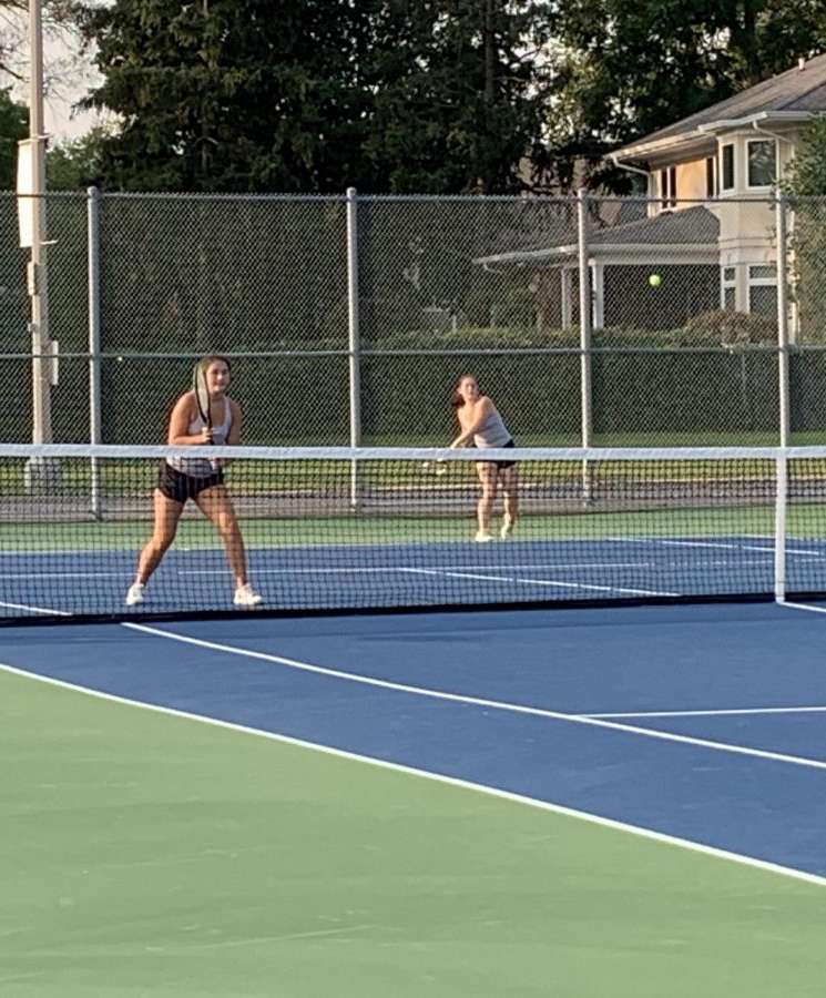 Senior+Jenna+Zaengle+%28left%29+follows+through+on+a+shot+while+her+partner%2C+junior+Michaela+Orvis%2C+prepares+for+their+opponent+to+hit+a+return+shot.